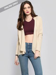 Beige, waffle knit cardigan featuring an open, drape fit, pockets at the hips and ribbed trim at the placket, cuffs and pockets