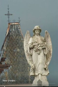 New Orleans I found rather creepy but this cemetery angel is beautiful....well creepy is not always bad...it's a feeling.