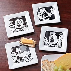 Invite Mickey and Goofy to your next party! Set of 4 ceramic plates with black & white cartoon images are perfect for appetizers, snacks, or canapes.