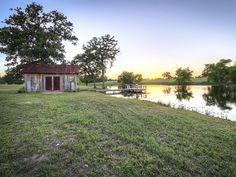 Talk about a picture perfect country getaway: This custom built 336-square-foot cabin sits on 24 sprawling acres in West Point, Texas—just steps from its own four-acre constant flow lake, tiny lakehouse, and wooden pier.