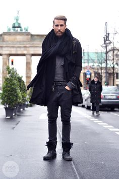 steez indeed. huge black scarf, combat boots and hipster mustache
