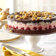 Cherry-Coconut Chocolate Torte Recipe -I love chocolate covered cherries and old-fashioned Cherry Mash candy. This wonderful torte reminds me of these two favorites. It will definitely suit your sweet tooth.