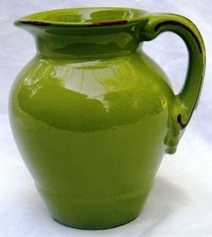 http://www.ebay.com/itm/Apple-Green-HandCrafted-Art-Pottery-Earthenware-Pitcher-Jug-w-Terracotta-Accents-/151372985728?hash=item233e887580
