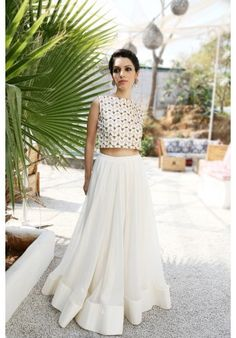 White crop top in cotton satin with triangle sequins and a white flared lehenga in georgette and shantoon lining