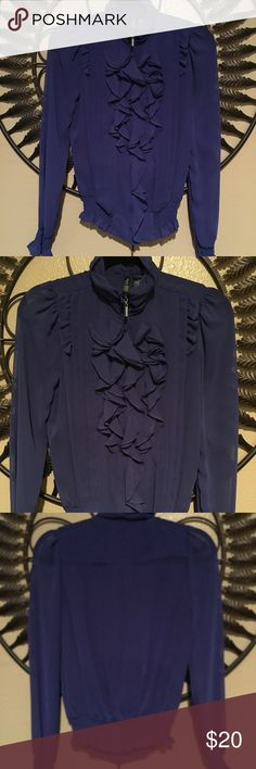 Victorian look sexy blouse This blouse is a statement piece. It has the ruffles in the middle and has cuff sleeves. The color is bettered purple and blue. Blouse never worn. Bisou Bisou Tops Blouses