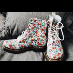 Dr. Marten floral boot Great Dr. Martin boots. They are awesome shoes and I have only worn them a few times. The tread is like new and they are nice shoes. Just cleaning out my closet. Bought them a couple months back. Dr. Martens Shoes Combat & Moto Boots
