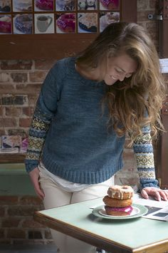 Ravelry: Astrid Pullover pattern by Michele Rose Orne   like the feel of this photo, especially the brickwork and the comfortable/comforting 'weekend morning in a cafe' look -- goes well with the sweater