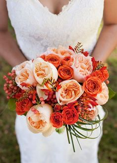 An elegant bouquet of pink garden roses, burnt orange roses and berries makes for the perfect fall arrangement. Click to check out our 10 Favorite Fall Wedding Bouquets.