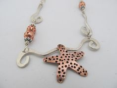 Starfish in the Waves necklace - Artisan hand crafted sterling silver and copper metalwork necklace by JoDeneMoneuseJewelry, $95.00