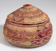 Africa | Basket most probably from Ethiopia | Plant fiber, dye and hide | ca. 1921