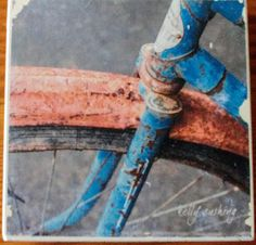 Blue Bike Wheel Coaster, Fine Art Photograph Manually Transferred to a Travertine Stone Tile, Backed with Cork for Table Protection Custom Coasters, Bike Wheel, Stone Tiles, Travertine, Decorating Your Home, Vintage Items, Fine Art, Awesome, Handmade