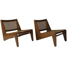 Pierre Jeanneret Le Corbusier Kangourou Easy Chairs Rosewood, 1950 | From a unique collection of antique and modern lounge chairs at https://www.1stdibs.com/furniture/seating/lounge-chairs/
