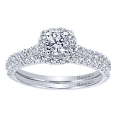 A complete white gold bridal set for the diamond lover. A woman can never have too many diamonds in her bridal set! This gorgeous 14k White Gold Diamond Halo Engagement Ring by Gabriel & Co. is so perfect. Let Gabriel & Co. customize your dream bridal set!