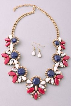 Edgy multi-color jewels arrange themselves in a gorgeous fringe statement necklace and earring set that can be worn over any look for instant sparkle and shine.
