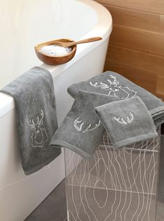 Exclusively from Simons Maison   Pretty decorative embroidery in a very trendy chic cottage decor style. You'll love the antlers pattern in a chic shiny accent white accent on soft modern charcoal velvety terry. Absorbent looped terry underside. Waffle ribbon edging.   Dimensions   Bath: 70 x 130 cm  Hand: 45 x 76 cm  Facecloth: 33 x 33 cm  Guest towel: 33 x 48 cm