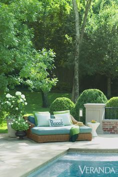 The poolside garden spans three loggias and terraced plots devised by landscape architecture firm Lambert's, and it splits the difference between elegance and ease to achieve a laid-back brand of luxury that's ideally suited for Horowitz and her three young children. Daybed with cushions and pillows in Perennials fabrics, Restoration Hardware. John Dickinson table, Sutherland.   - Veranda.com