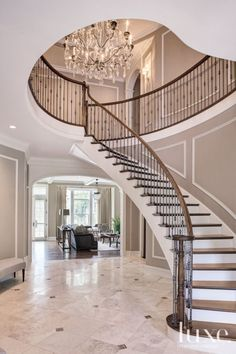Beloved antique furnishings and collected objects from this beautiful home inspire this week's finds. Wrought Iron Staircase, Foyer Staircase, Entry Stairs, Curved Staircase, House Stairs, Staircases, Staircase Molding, Entry Hall, Railing Design
