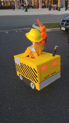 Halloween costumes 2016: Aidan wanted to be a giant excavator and wanted his little brother to be a cone. done! this is the back.