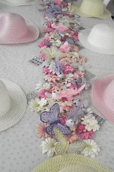 Hats to decorate and decorations stacked in the middle of the table.  Looks like such fun for a Tea Party!