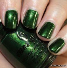 Metallic green nail polish.