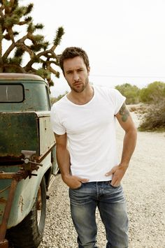 Alex O'Loughlin {love the look + the beat up truck behind him. also, ohai tats}