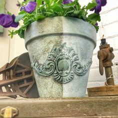 Garden pot with silicon mould appliqué