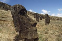 Giant moai statues dot the grassy flanks of a dead volcano on Easter Island. These massive stone sculptures were likely built by Polynesians thought to have colonized the tiny South Pacific island some 800 years ago. National Geographic, Easter Island Statues, Places To Travel, Places To Visit, Exterior, Ancient Artifacts, South Pacific, Types Of Art, Natural Wonders