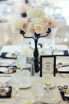 This is the type of center piece that works well on a table.  It is tall enough that you can talk to the people across from you.  Aren't the flowers lovely?