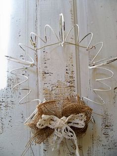 Rusty recycled bed spring wreath hand painted farmhouse wall decor Anita Spero. $35.00, via Etsy.