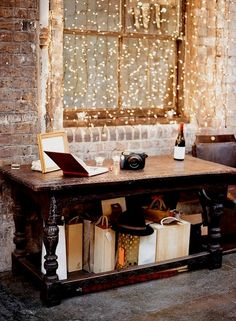 brick walls + hanging string lights.