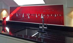 It's all at sea again with this yacht themed splashback, ordered by one of our clients on the Isle of Wight. This beautiful bespoke piece features hues of fiery red, black, white and silver as the yachts carve their way across the piece in a crimson sunset. This bespoke art is perfect for it's coastal location and we're glad our client enjoyed the artwork. Their kitchen splashback will become a focal point of attention for years to come, we hope!