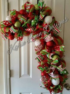This wreath is made with red and green deco mesh. Ribbon, christmas bulbs and decor to accent. Perfect for the Holidays! Christmas Front Doors, Christmas Wreaths To Make, Christmas Swags, Diy Christmas Gifts, Holiday Wreaths, Christmas Projects, All Things Christmas, Christmas Decorations, Christmas Candy