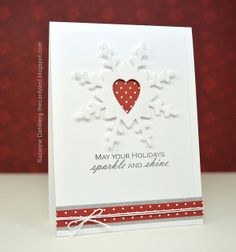 handmade card ... clean and simple ... sparkly die cut snowflake ... luv the negative space heart in the middle with red polka dot paper behind ...