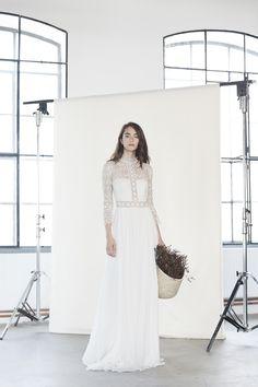 Luna - Boho style wedding dress made of silk muslin with revealed shoulders and flared sleeves.