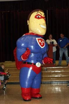 League City's Water Mascot, Captain H20 visits an elementary school to make his conservation presentation.