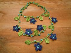 crochet necklace lariat blue flowers green leaves