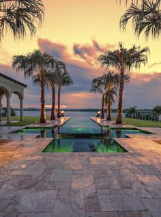 This infinity pool is lined with fantastic palm trees. These trees introduce a sense of motion down the length of the infinity pool and out to the ocean. Using trees like this can be great for drawing the eyeline in a desired direction. Palm Trees Landscaping, Backyard Landscaping, Tree Designs, Pool Designs, Luxury Garden Furniture, Balcony Design, Winter Trees, Small Trees, Garden Styles