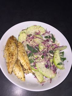 Fried salt and ground black pepper chicken fillet served with thinly sliced red and green cabbage with green apples and trim mayo