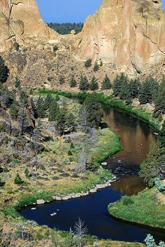 Smith Rock State Park is a state park located in central Oregon's high desert near the towns of Redmond and Terrebonne. Its sheer cliffs of tuff and basalt are ideal for rock climbing of all difficulty levels.