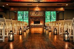 Aisle lined with lanterns for a charming and cozy indoor ceremony