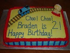 Thomas the Train Birthday Cake - This was a Thomas Cake done for a little boy's 2nd birthday.  It was a 1/2 sheet yellow cake with buttercream icing.  I modified a cake idea I saw in a birthday express catalog.
