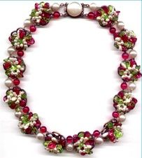 Rousselet necklace of floral volutes set with cranberry and citrine glass beads and pearls.