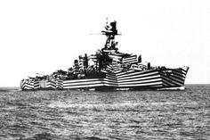 World War I- Camouflaged Sub. (British Artist and naval officer Norman Wilkinson had this very insight and pioneered the Dazzle Camouflage movement (known as Razzle Dazzle in the United States). Norman used bright, loud colours and contrasting diagonal stripes to make it incredibly difficult to gauge a ship's size and direction.)