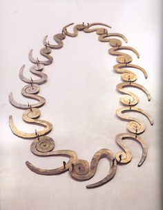 Alexander Calder. Spiral Necklace. Between 1920 and 1950. Stroking with a hammer, bending, chiseling or twisting the metals, he creates his objects. He seldom welds elements and he doesn't polish the surfaces.