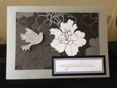 Black, white and gray card with a silver dimensional bird