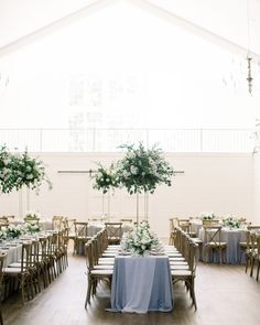 Tall centerpieces lend themselves well to rooms with high ceilings. Here, Magnolia Belle Floral created high-and-low arrangements of garden roses and greenery to fill this airy reception space. Tall Wedding Centerpieces, Unique Centerpieces, Wedding Table Decorations, Wedding Flower Arrangements, Flower Bouquet Wedding, Floral Wedding, Centerpiece Ideas, Flower Bouquets, Bridal Bouquets