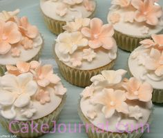 Peach flower cupcakes. Cupcakes decorated with sugar flowers.  I have used 5-petal blossom & Petunia cutters and a silicone 5 petal veiner. All flowers are dusted with petal dust.  Want to read more about cookies, cakes and decoration? Visit my cake blog www.cakejournal.com