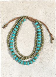 Blue as the sky, our multi-strand brass-and- turquoise bead bracelet.