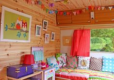 Trailer interior bright colors and owls vintage camper