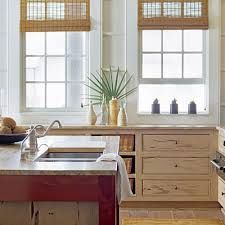 Decided to paint the cabinets to look like old weathered painted boards for a beachy look. We went a bit lighter than this picture, using Behr Café Cream as the base and Basketry for the faux wood grain.